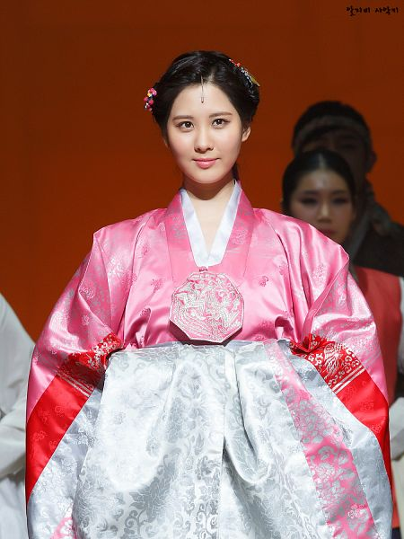 Tags: K-Drama, Girls' Generation, Seohyun, Pink Outfit, Hair Ornament, Looking Up, Pink Dress, Brown Background, Traditional Clothes, Hanbok, Hair Up, Moon Embracing the Sun