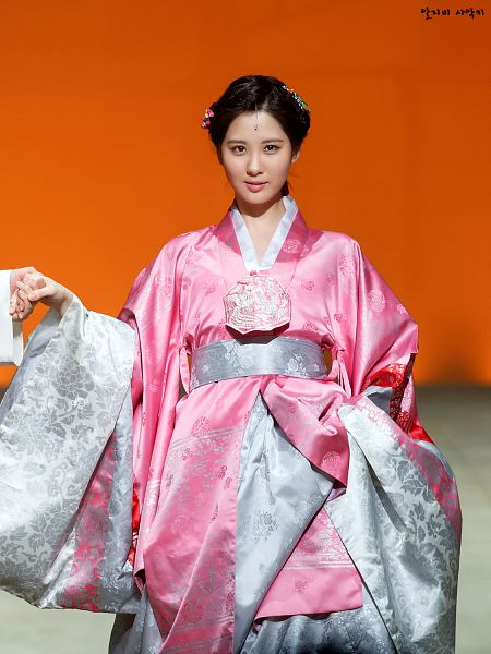 Tags: K-Drama, Girls' Generation, Seohyun, Pink Outfit, Traditional Clothes, Pink Dress, Hanbok, Skirt, Holding Skirt, Holding Hands, Orange Background, Hair Up