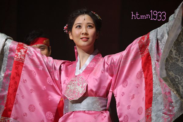 Tags: K-Drama, Girls' Generation, Seohyun, Pink Outfit, Hanbok, Hair Up, Looking Up, Arms Out, Traditional Clothes, Pink Dress, Dark Background, Black Background