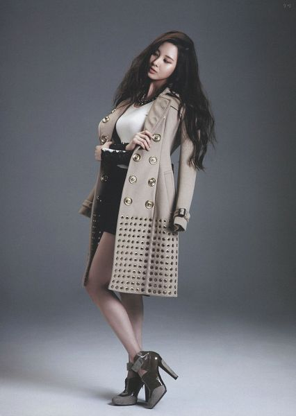 Tags: SM Town, K-Pop, Girls' Generation, Seohyun, Black Dress, Crossed Legs (Standing), Gray Background, Eyes Closed, Brown Outerwear, Crossed Arms, High Heels, Bare Legs