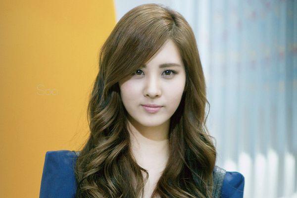 Tags: SM Town, K-Pop, Girls' Generation, Seohyun, Wavy Hair, Yellow Background, Blue Outerwear, Light Background, White Background, Blue Jacket