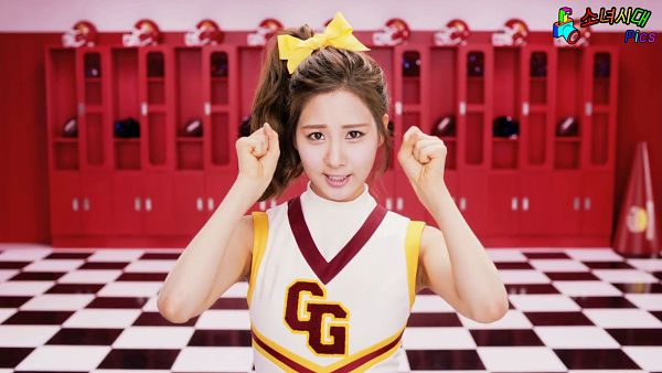 Tags: SM Town, K-Pop, Girls' Generation, Oh!, Seohyun, Checkered Floor, Red Background, Bare Shoulders, Sleeveless, Hair Bow, Hair Up, Bow