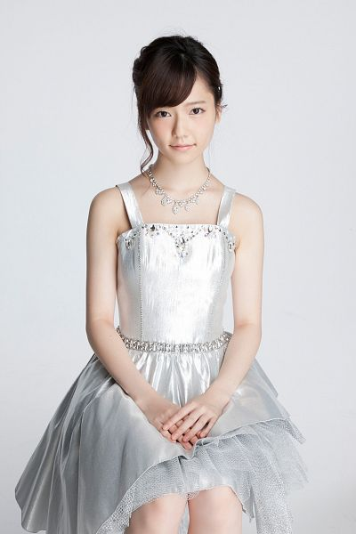 Tags: J-Pop, AKB48, Shimazaki Haruka, Bare Legs, White Dress, Collarbone, Hand On Leg, Medium Hair, Gray Outfit, Necklace, Silver Dress, Gray Background