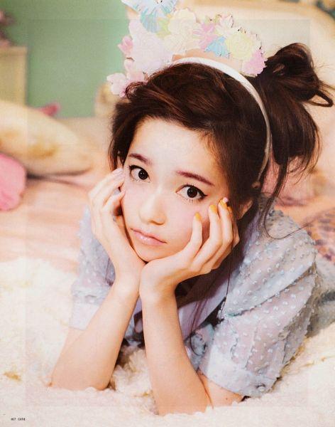 Tags: J-Pop, AKB48, Shimazaki Haruka, Laying On Stomach, On Bed, Bed, Hair Up, Hairband, Make Up, Hand On Cheek, Hand On Head, Blue Shirt