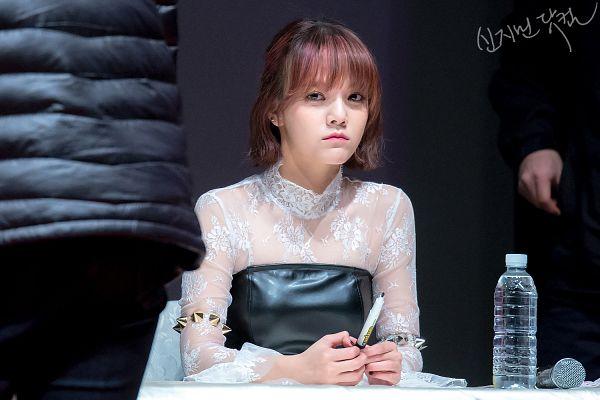 Tags: K-Pop, AOA (Ace Of Angels), Shin Jimin, Water, Dark Background, Pen, Korean Text, Sitting On Chair, Frown, Medium Hair, Bottle, Chair