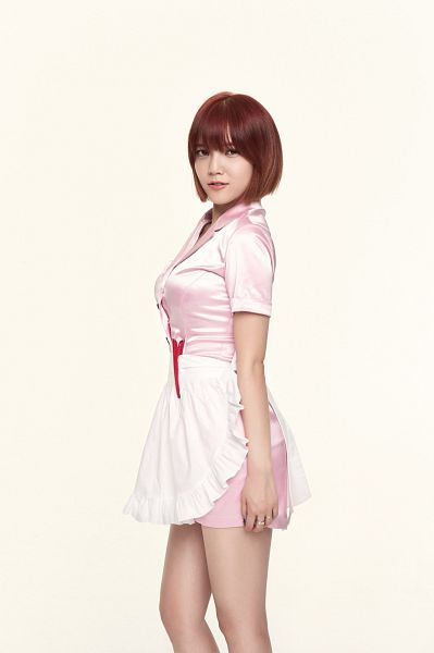 Tags: K-Pop, AOA (Ace Of Angels), Shin Jimin, Ring, Pink Outfit, Medium Hair, Apron, Pink Dress, Bare Legs, Light Background, White Background