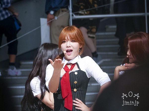 Tags: K-Pop, AOA (Ace Of Angels), Shin Jimin, Tie, Blow a Kiss, Red Neckwear, Hair Up, Detached Collar, Striped, Black Dress, Kiss, Hand On Hip