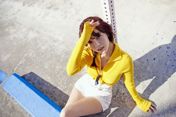 Tags: K-Pop, AOA (Ace Of Angels), Good Luck (Song), Shin Jimin, Medium Hair, Yellow Outerwear, White Shorts, Shorts, Sitting On Ground, Tongue, From Above, Looking Up