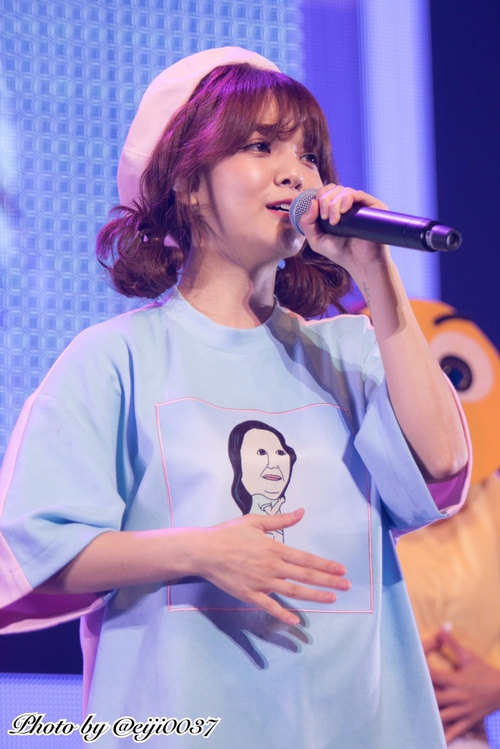 Tags: K-Pop, AOA (Ace Of Angels), Shin Jimin, Looking Away, Pink Headwear, Microphone, Singing, Teeth, Hat, Hair Buns, Hair Up, Twin Buns