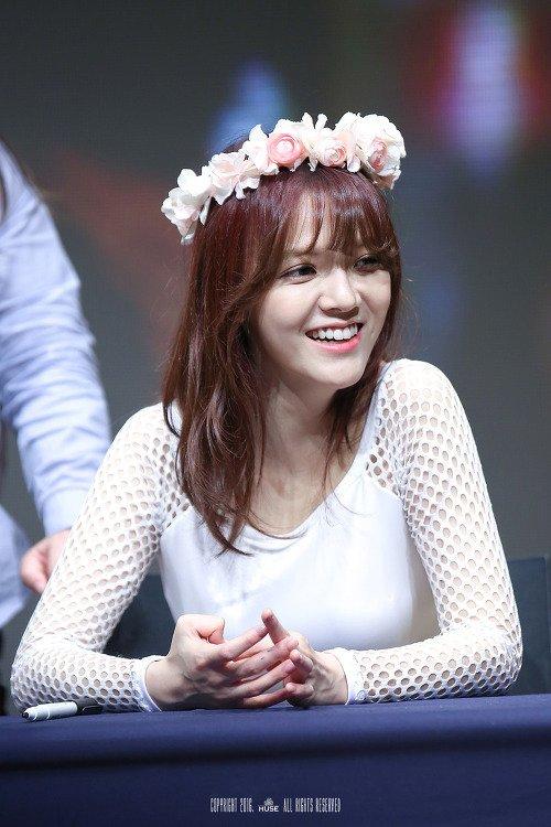 Tags: K-Pop, AOA (Ace Of Angels), Shin Jimin, Teeth, Flower, Bent Knees, Table, Flower Crown, Sitting, Black Eyes, Looking Away, Hair Ornament