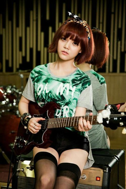 Tags: K-Pop, AOA (Ace Of Angels), Shin Jimin, Thigh Highs, Sitting, Bracelet, Black Shorts, Shorts, Ribbon, Guitar, Green Shirt, Jewelry
