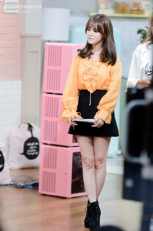 Tags: K-Pop, AOA (Ace Of Angels), Shin Jimin, Skirt, Crossed Legs, Black Skirt, Boots, Orange Shirt, Sitting, Black Eyes, Standing, Looking Away