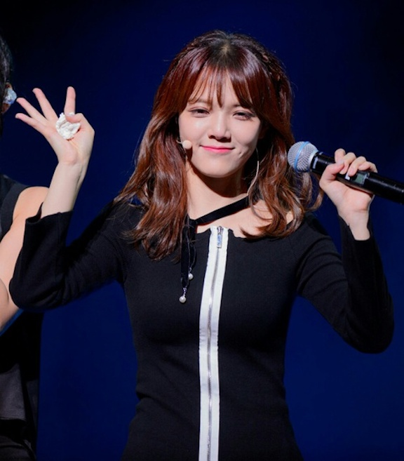 Tags: K-Pop, AOA (Ace Of Angels), Shin Jimin, Dress, Looking Ahead, Simple Background, Looking Down, Black Dress, Blue Background, Wave, Microphone, Black Outfit