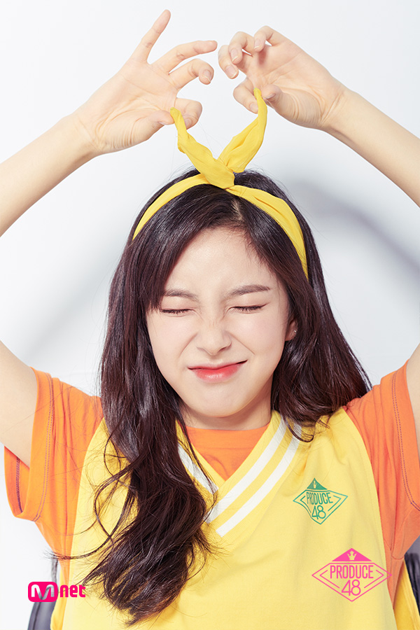 Tags: Television Show, K-Pop, Shin Suhyun, Arms Up, Text: Series Name, Light Background, Hair Bow, Make Up, Hair Ornament, White Background, Sweater, Short Sleeves