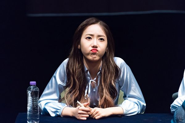 Tags: K-Pop, G-friend, SinB, Multi-colored Hair, Pen, Pouting, Looking Ahead, Bottle, Blue Dress, Dark Background, Holding Object, Blue Outfit