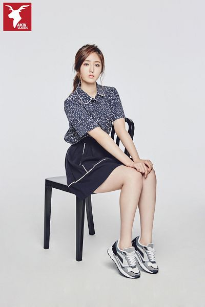 Tags: K-Pop, G-friend, SinB, Full Body, Blue Skirt, Chair, Sneakers, Sitting, Gray Background, Bent Knees, Sitting On Chair, Short Sleeves