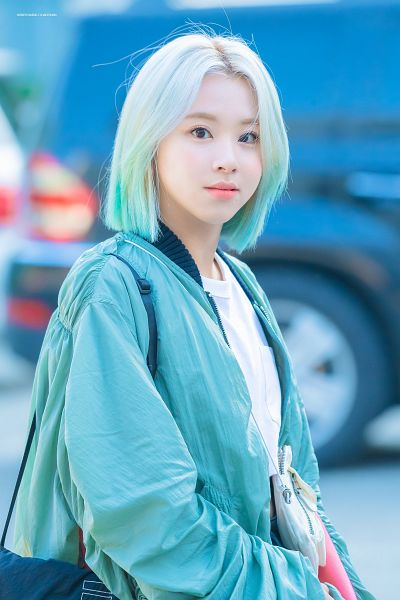 Tags: K-Pop, Twice, Son Chaeyoung, Blue Hair, Multi-colored Hair, Blue Jacket, Blonde Hair, Outdoors, Bag, Blue Outerwear