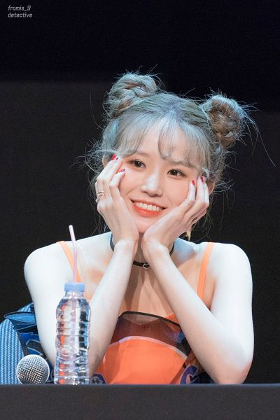 Tags: K-Pop, fromis 9, Song Hayoung, Sitting On Chair, Nail Polish, Hair Buns, Twin Buns, Looking Away, Bottle, Hair Up, Hand On Head, Necklace