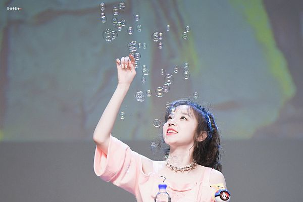 Tags: K-Pop, (G)-I-DLE, Song Yuqi, Make Up, Wavy Hair, Bubbles, Short Sleeves, Looking Up, Pink Shirt, Hair Up, Arms Up, Ponytail