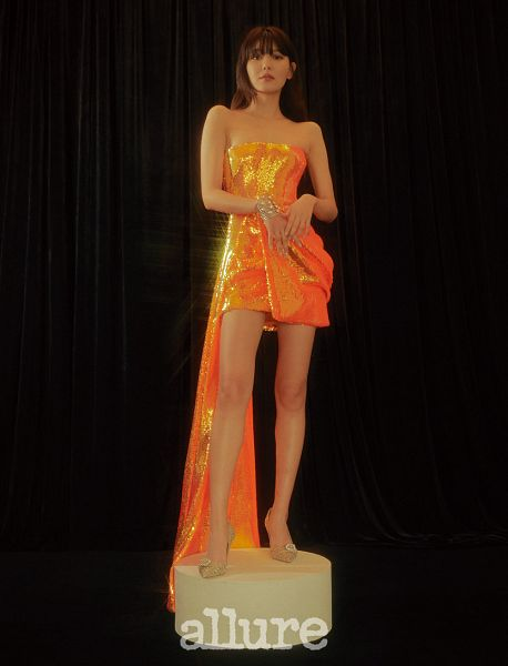 Tags: K-Pop, Girls' Generation, Sooyoung, Orange Outfit, Sleeveless, Bare Legs, Dark Background, Collarbone, Shoes, Text: Magazine Name, Orange Dress, High Heels
