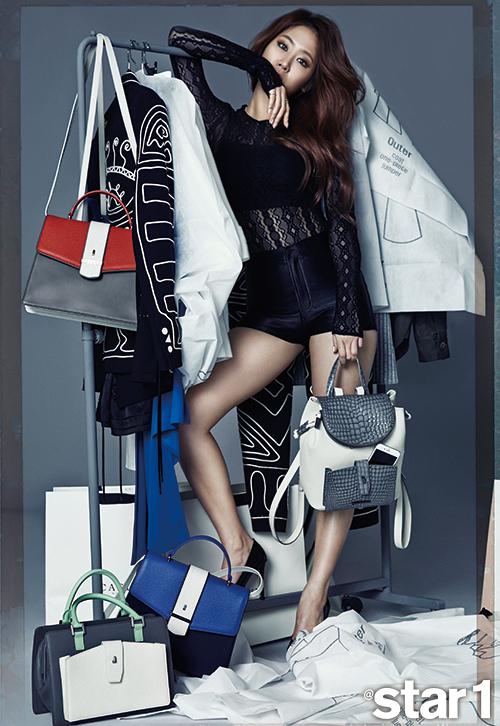 Tags: Sistar, Soyou, Text: Magazine Name, Shorts, Black Footwear, High Heels, Black Shorts, Bag, Covering Mouth, Star1