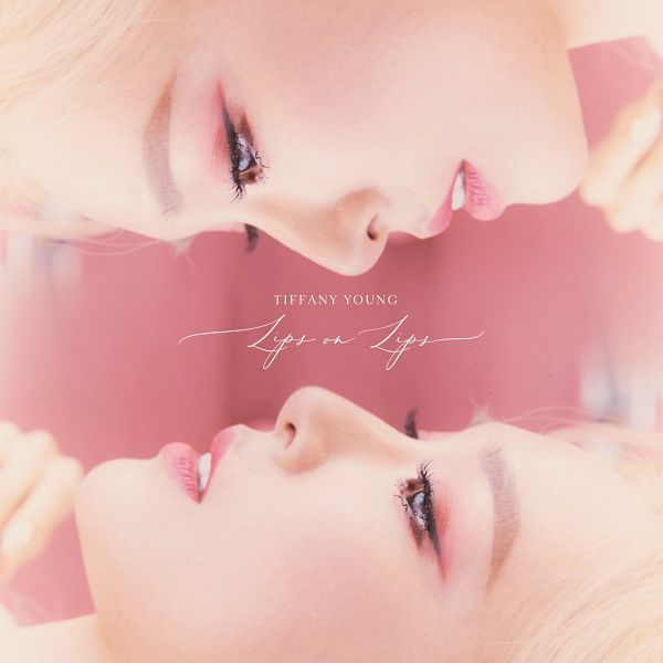 Tags: K-Pop, Girls' Generation, Stephanie Young Hwang, Pink Background, Text: Song Title, Blonde Hair, Text: Artist Name, Lips On Lips