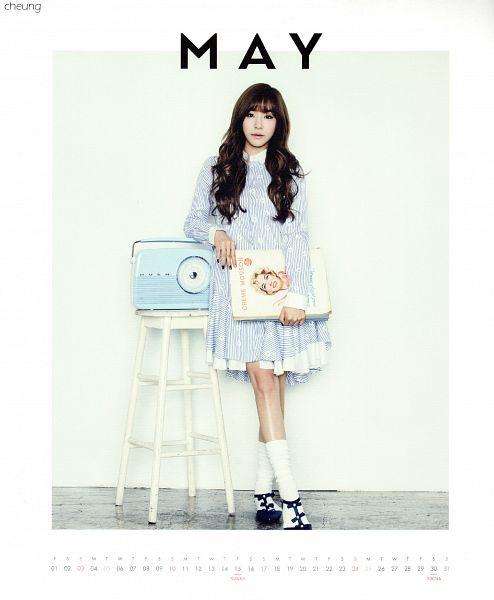 Tags: K-Pop, Girls' Generation, Stephanie Young Hwang, Blue Outfit, White Border, Socks, Book, Text: Calendar Date, Wavy Hair, White Legwear, Light Background, Bare Legs