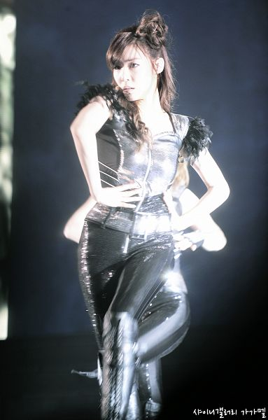 Tags: K-Pop, Girls' Generation, Stephanie Young Hwang, Hair Up, Silver Shirt, Knee Boots, Black Background, Matching Outfit, Standing On One Leg, Boots, Black Footwear, Walking