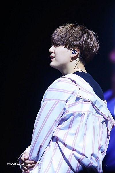 Tags: K-Pop, Bangtan Boys, Suga, Looking Ahead, Bangs, Striped Shirt, Jewelry, Dark Background, Blunt Bangs, Short Hair, Simple Background, Striped