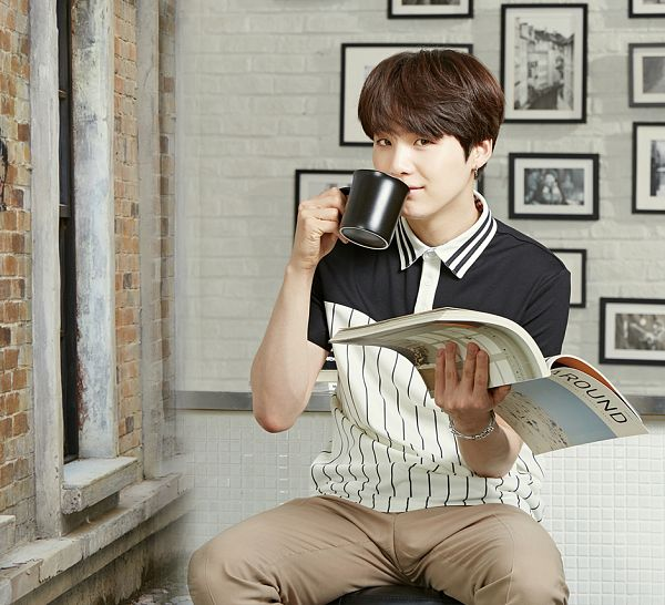 Tags: K-Pop, BTS, Suga, Brown Pants, Black Eyes, Drinks, Drinking, Book, Blue Shirt, Open Book, Cup, Short Sleeves