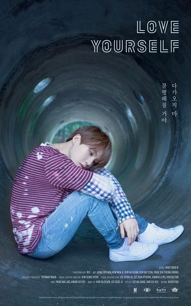 Tags: K-Pop, BTS, Suga, English Text, White Footwear, Text: Company Name, Shoes, Striped, Necklace, Sneakers, Text: Artist Name, Jeans
