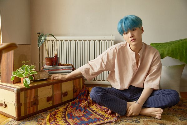 Tags: K-Pop, BTS, Suga, Sitting On Ground, Head Tilt, Indoors, Blue Hair, Striped Pants, Blunt Bangs, Plant, Hand On Leg, Carpet