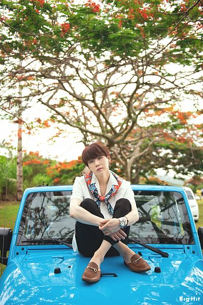 Tags: K-Pop, BTS, Suga, Outdoors, English Text, Text: Company Name, Necklace, Collar (Clothes), Watch, Car, Bracelet, Tree