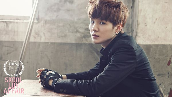 Tags: K-Pop, BTS, Suga, School Uniform, Text: Album Name, Leather Jacket, Gloves, Black Gloves, Black Jacket, Text: Artist Name, Chair, Sitting On Chair
