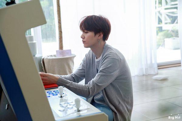 Tags: K-Pop, BTS, Suga, Curtain, Gray Shirt, English Text, Side View, Arcade, Text: Company Name, Window, BTS 2019 Season's Greetings