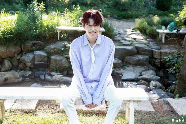 Tags: K-Pop, BTS, Suga, Eyes Closed, Text: Company Name, Sitting On Bench, English Text, Bench, Grin, BTS 2019 Season's Greetings
