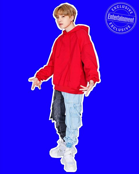 Tags: K-Pop, BTS, Suga, Blue Pants, Hood, Red Shirt, Hoodie, Serious, English Text, White Footwear, Blue Background, Full Body