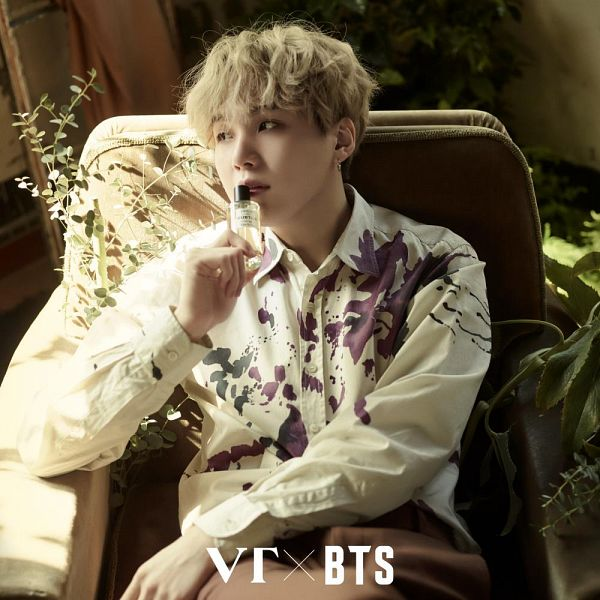 Tags: K-Pop, BTS, Suga, Text: Artist Name, Brown Pants, Plant, Looking Away, Armchair, Text: Brand Name, Chair, VT Cosmetics, Twitter