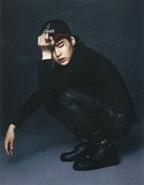 Tags: K-Pop, Bangtan Boys, Suga, Hat, Black Jacket, Gray Background, Ring, Black Footwear, Eyes Closed, Crouching, Red Hair, Tattoo