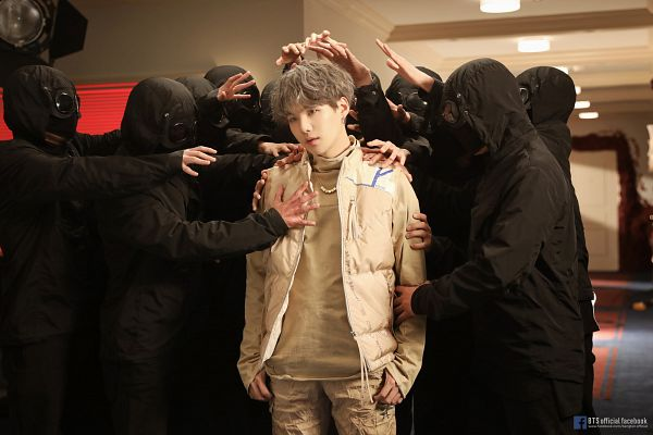 Tags: K-Pop, BTS, Interlude: Shadow, Suga, Text: URL, Collar (Clothes), Wavy Hair, Text: Artist Name, Necklace, Turtleneck, Indoors, Head Tilt
