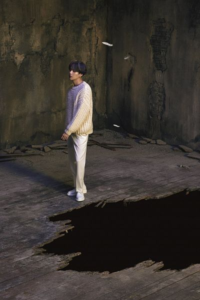 Tags: K-Pop, BTS, Suga, Hole, Eyes Closed, Feather, Dark Background, Shoes, White Footwear, Indoors, Sweater, White Outfit