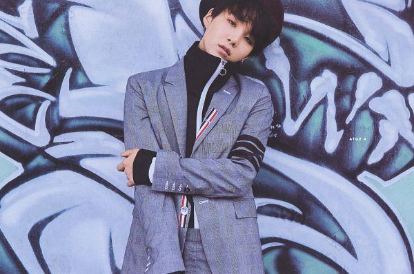 Tags: K-Pop, BTS, Suga, Hat, Blue Jacket, Black Eyes, Turtleneck, Head Tilt, Wall, Serious, Blue Outerwear, Blue Pants