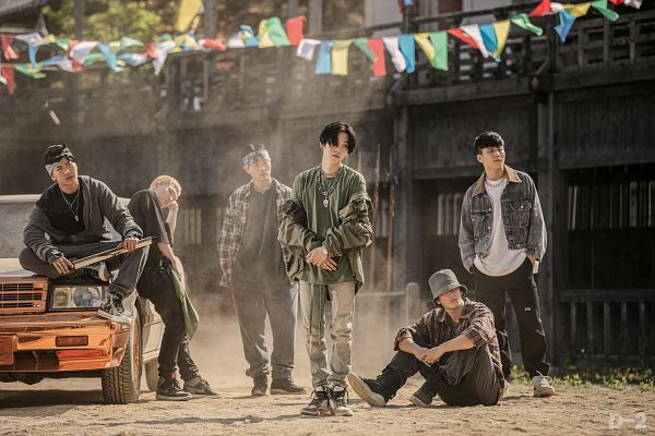 Tags: K-Pop, BTS, Daechwita, Suga, Camouflage Print, Group, Text: Album Name, Outdoors, Hand In Pocket, Green Shirt, Facial Mark, Necklace