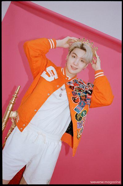Tags: K-Pop, BTS, Suga, Headdress, Dutch Angle, Arms Up, Black Border, Ring, Shorts, White Shorts, Crown, Pink Background