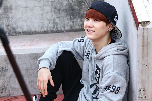 Tags: K-Pop, BTS, Suga, Hoodie, Black Pants, Looking Up, Sitting On Stairs, Grin, Black Headwear