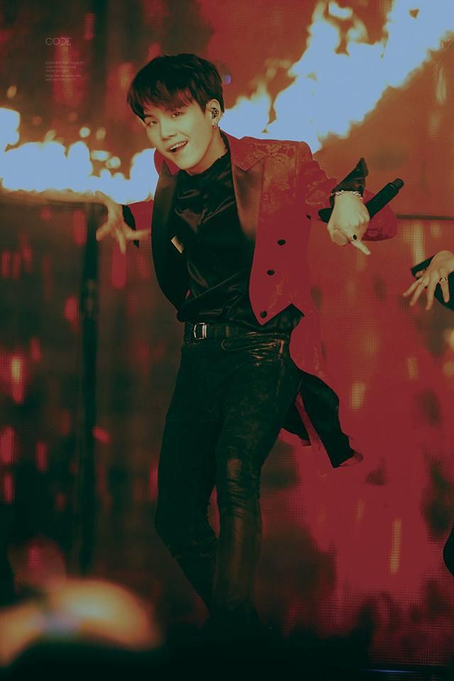 Tags: K-Pop, Bangtan Boys, Suga, Belt, Stage, Black Eyes, Microphone, Fire, Dancing, Black Shirt, Earbuds, Red Jacket