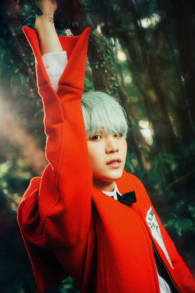 Tags: K-Pop, BTS, Suga, Outdoors, Tattoo, Green Hair, Red Outerwear, Bow Tie, Plant, Tree, Red Jacket, Forest