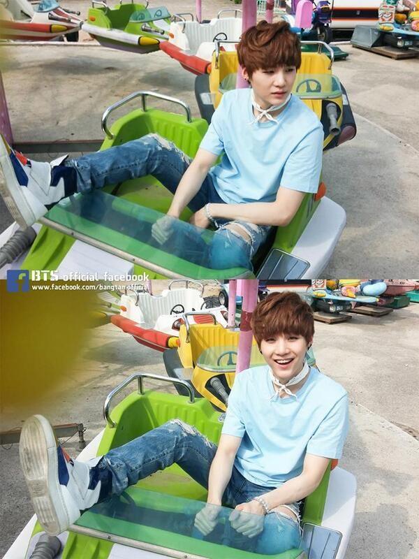 Tags: K-Pop, BTS, Suga, Blue Shirt, Blue Pants, Looking Away, Ripped Pants, Black Eyes, Jeans, Amusement Park, Serious