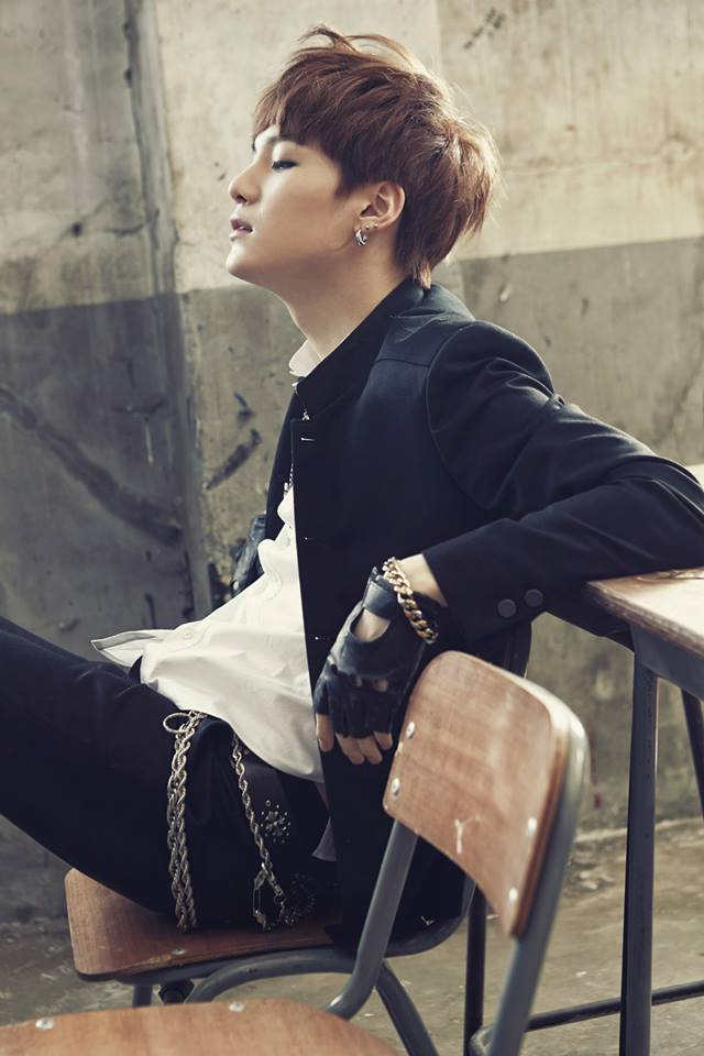 Tags: K-Pop, BTS, Suga, Black Jacket, Bracelet, Fingerless Gloves, Side View, Table, Sitting On Chair, Looking Away, Black Pants, School Uniform