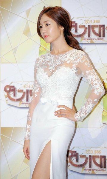 Tags: K-Pop, Fin.K.L, Sung Yuri, Hand On Hip, Dress Slit, White Outfit, White Dress
